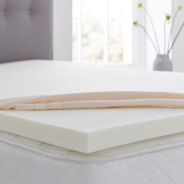 silentnight memory foam topper on a bed